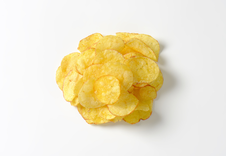 Heap of crunchy potato crisps