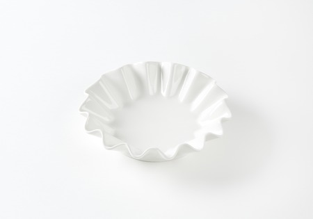 fluted: Empty fluted white fruit bowl