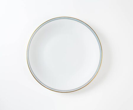 rimless: Coupe shaped white plate with blue band and gold trim
