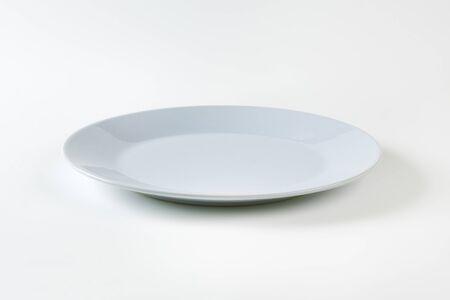 rimless: Empty round gray dinner plate