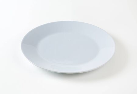 rimless: Empty round gray dinner plate