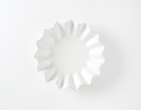 fruit bowl: Empty fluted white fruit bowl
