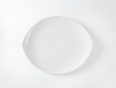 coupe: Pointed oval white coupe plate
