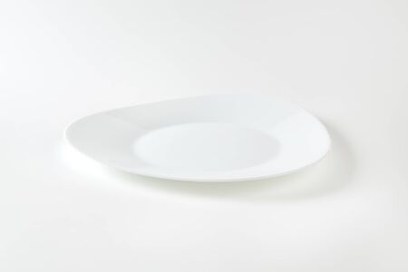 rounded edges: Triangle white plate with rounded edges and wide rim