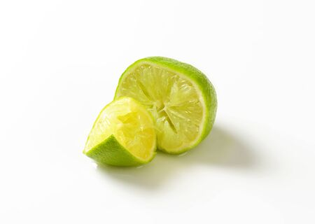 squeezed: Half a lime fruit - squeezed Stock Photo