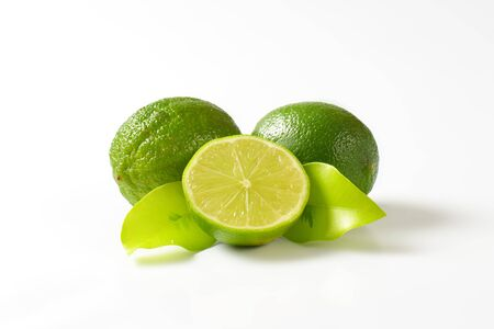 cross section: Lime fruits, in cross section and whole Stock Photo