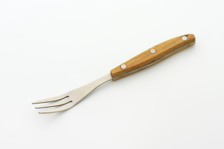 tines: Three pronged fork with wooden handle