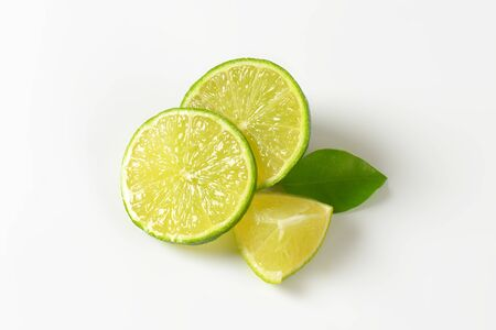 Slices of fresh lime on white background