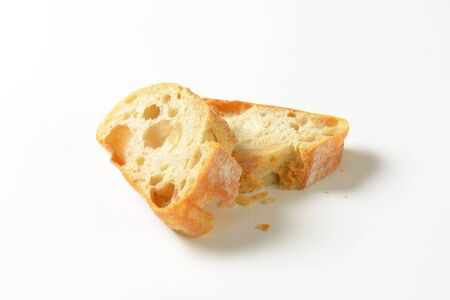 crust crusty: Ciabatta bread slices on white background Stock Photo