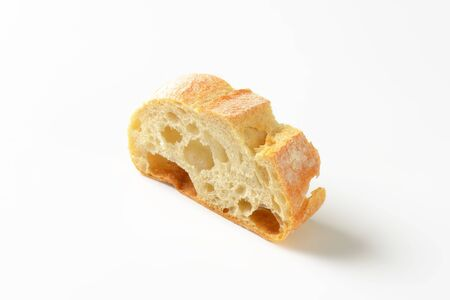 crust crusty: Ciabatta bread slice on white background