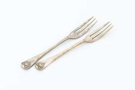 tines: Vintage ornate forks with three tines