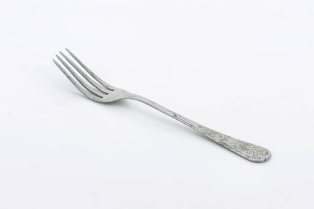 etched: Old dinner fork decorated on the handle