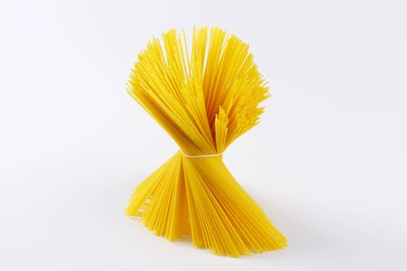 long shots: uncooked spaghetti tied in bundle