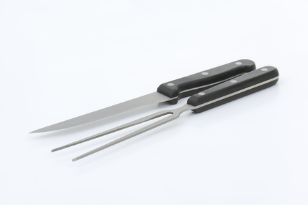 serving utensil: carving knife and fork with black handle Stock Photo