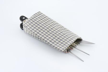 dishtowel: carving set wrapped in checkered dishtowel Stock Photo
