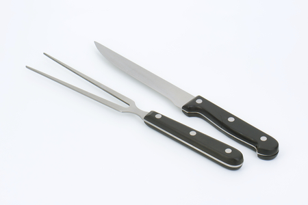 serving utensil: carving knife and fork on white background Stock Photo