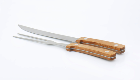 serving utensil: Wood-handled carving knife and fork set Stock Photo