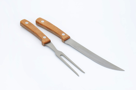 long handled: Wood-handled carving knife and fork set Stock Photo