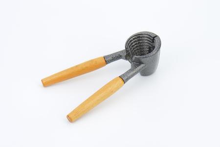 nut cracker: Metal funnel-shaped walnut cracker with wooden handles