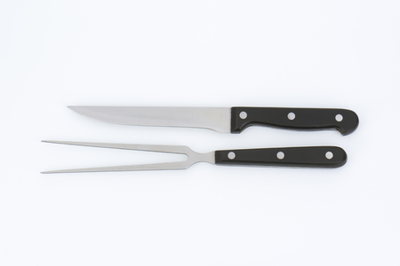 long shots: carving knife and fork with black handle Stock Photo