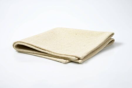 place mat: Small folded linen place mat Stock Photo