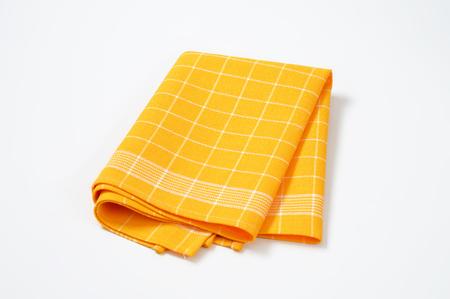 plié damier jaune serviette de cuisine Banque d'images