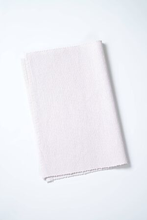 folded white cloth place mat