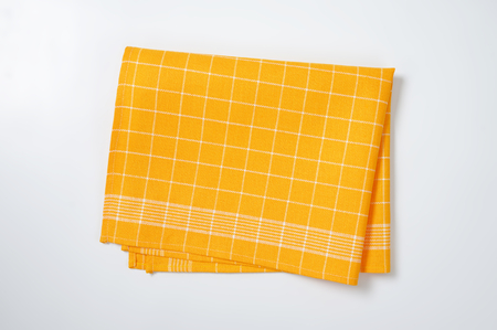 folded yellow checkered kitchen towel