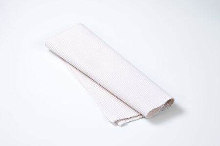 place mat: folded white cloth place mat