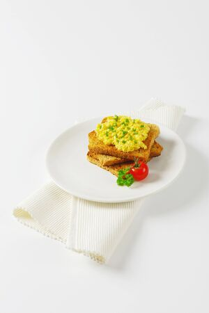 chives: Scrambled eggs with chopped chives on toast Stock Photo