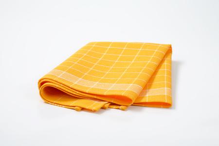 tela algodon: plegada toalla de cocina a cuadros de color amarillo
