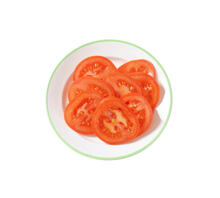 tomato slices: Red tomato slices isolated on white