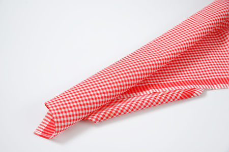 checked: red and white checked tea towel Stock Photo