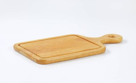 paddle cutting board with groove