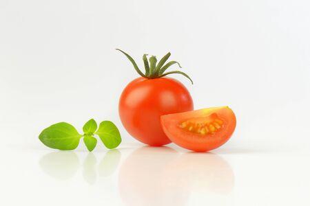 quarter: whole red tomato and quarter Stock Photo