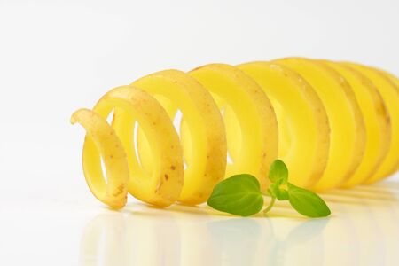 raw potato: raw potato cut with spiral cutter