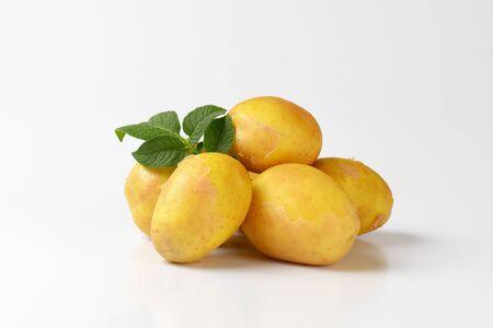 unpeeled: heap of unpeeled new potatoes Stock Photo