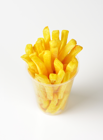 pomme: portion of French fries in plastic cup Stock Photo