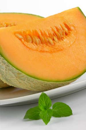 sliced cantaloupe melon on white plate Stock Photo