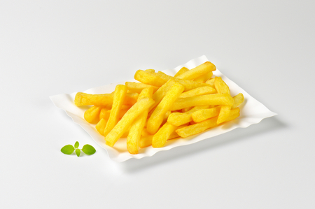 a portion: portion of French fries on paper plate Stock Photo