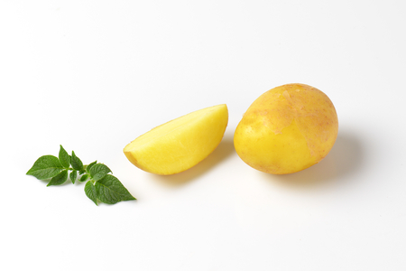 wedge: raw unpeeled potatoes - whole and wedge