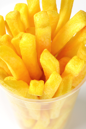 frites: portion of French fries in plastic cup Stock Photo