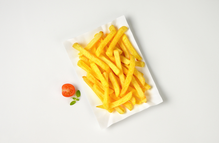 french fries plate: portion of French fries on paper plate Stock Photo