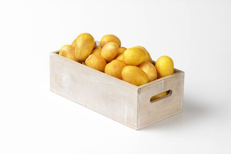 unpeeled: box of raw unpeeled potatoes