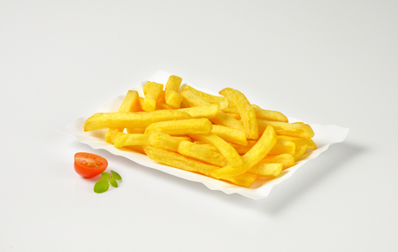 portion: portion of French fries on paper plate Stock Photo