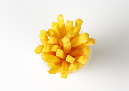 a portion: portion of French fries in plastic cup Stock Photo