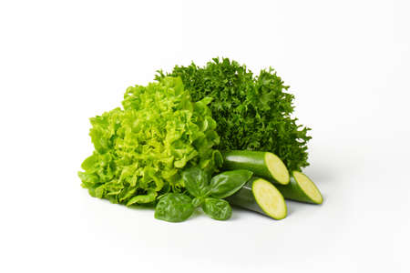 courgettes: lollo bionda and butterhead lettuce with courgettes on white background