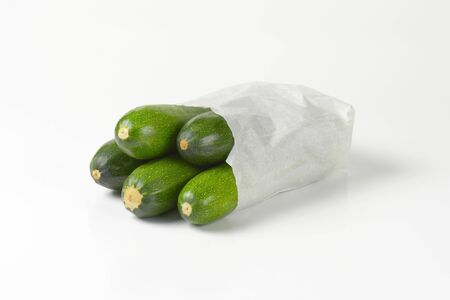courgettes: fresh courgettes in paper bag Stock Photo