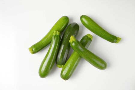 courgettes: fresh courgettes on white background
