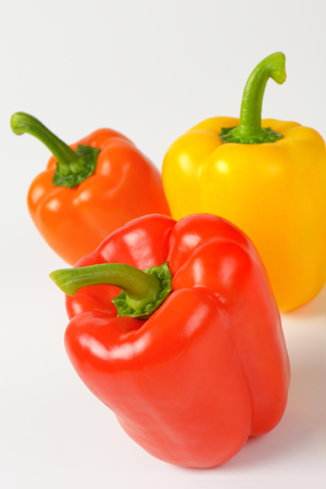 varieties: closeup of three ripe bell pepper varieties Stock Photo